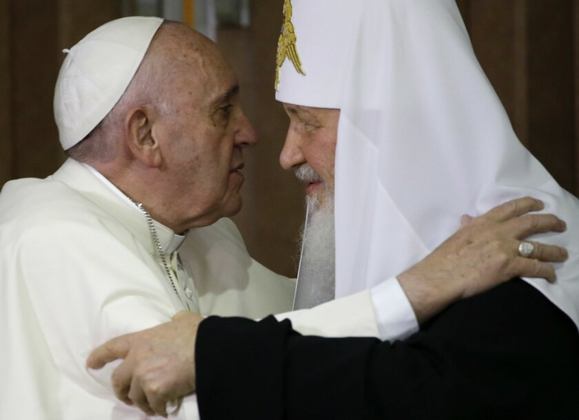Pope Francis, left, embraces Russian Orthodox Patriarch Kirill after signing a joint declaration on religious unity at the Jose Marti International airport in Havana, Cuba, Friday, Feb. 12, 2016. The two religious leaders met for the first-ever papal meeting, a historic development in the 1,000-yea