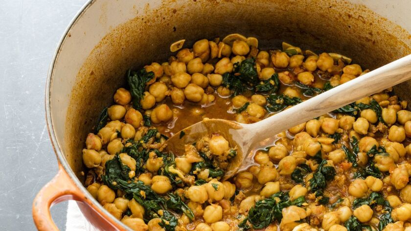 This undated photo provided by America's Test Kitchen in February 2019 shows Chickpeas with Spinach,