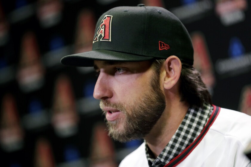 Newly acquired Arizona Diamondbacks pitcher Madison Bumgarner speaks after being introduced during a team availability, Tuesday, Dec. 17, 2019, in Phoenix.