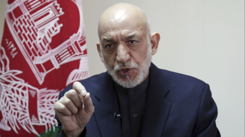 Former Afghan President Hamid Karzai speaks during an interview in Kabul, Afghanistan, on Feb. 16.