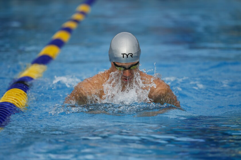 Christian High School's Noah Snyder swims the breaststroke leg of the 200 medley relay.