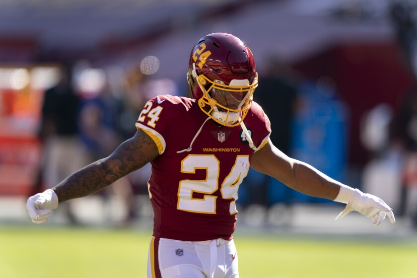 Washington Football Team running back Antonio Gibson (24) warming up before the start of an NFL football game against the New York Giants, Sunday, Nov. 8, 2020, in Landover, Md. (AP Photo/Al Drago)