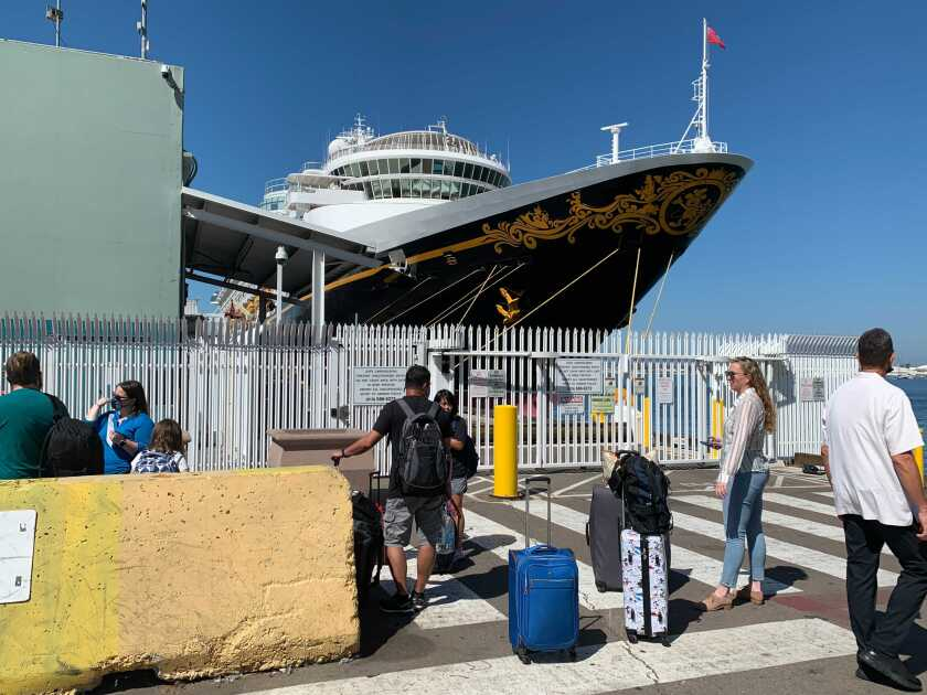 Passengers board the Disney Wonder for a test cruise.