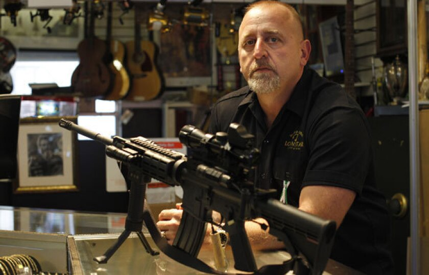 """Pawn shop owner Frank James has decided to discontinue selling all fire arms including this Bushmaster AR-15 at his shop, Loanstar Jewelry and Pawn, in Seminole, Florida. James, the father of a first grader says, """"I didn't want her thinking daddy's an evil guy, he sells guns."""" Guns sales are about 50 percent of his revenue."""