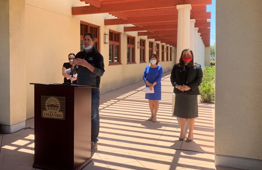 Imperial Beach Mayor Serge Dedina asks the County to increase testing. In the background, Mayors Mary Casillas Salas and Alejandra Sotelo-Solis, as well as San Diego Councilwoman Vivian Moreno all wear protective facemasks while standing six feet apart from each other.