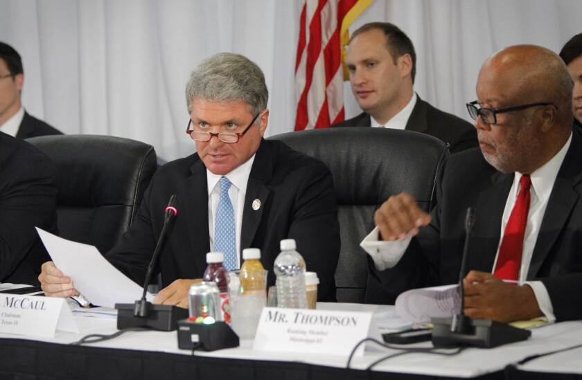 Rep. Michael McCaul (R-Texas), left, and Rep. Bennie Thompson (D-Miss.) preside over a hearing of the House Committee on Homeland Securty on the federal, state and local response to the Ebola case in Dallas.