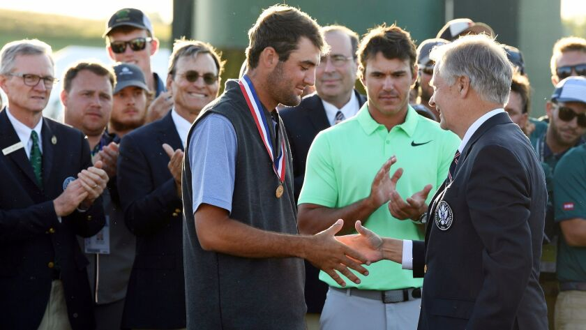 Xander Schauffele, 23, of San Diego, is congratulated for being the low amateur at the June 18 award