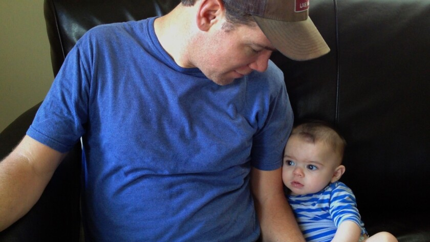 """Former New Orleans Saints safety Steve Gleason (left) appears with his son Rivers in a scene from the documentary """"Gleason."""""""