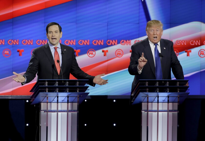 Sen. Marco Rubio, left, and Donald Trump face off during the Republican presidential debate in Houston on Thursday.