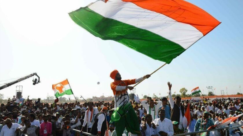 Supporters of India's opposition Congress party cheer at an election rally outside the city of Ahmedabad on March 12.