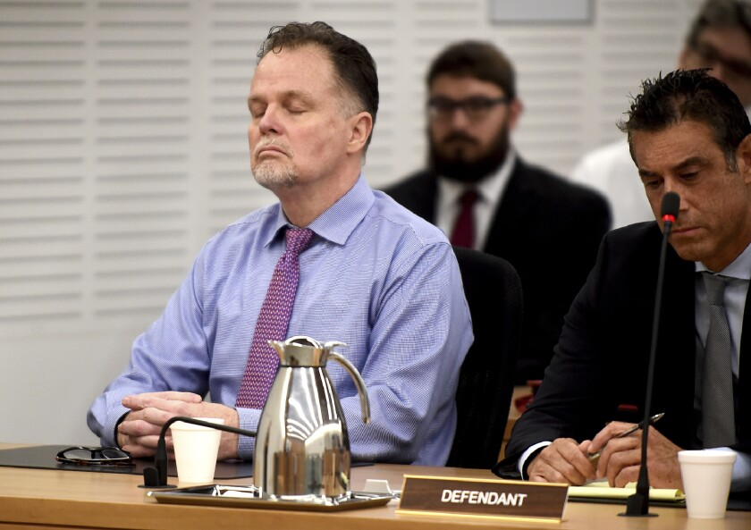 """Charles """"Chase"""" Merritt, left, reacts after being found guilty of four counts of first-degree murder, in court at the San Bernardino Superior Court in San Bernardino on June 10. He was convicted in the 2010 deaths of the McStay family of Fallbrook."""
