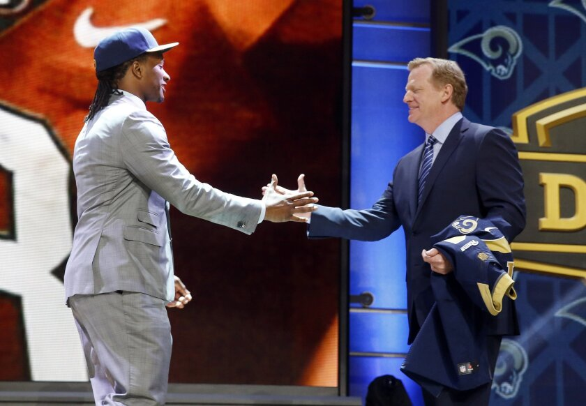 Georgia running back Todd Gurley shakes hands with NFL commissioner Roger Goodell after being selected by the St. Louis Rams as the 10th pick in the first round of the 2015 NFL Draft,  Thursday, April 30, 2015, in Chicago. (AP Photo/Charles Rex Arbogast)