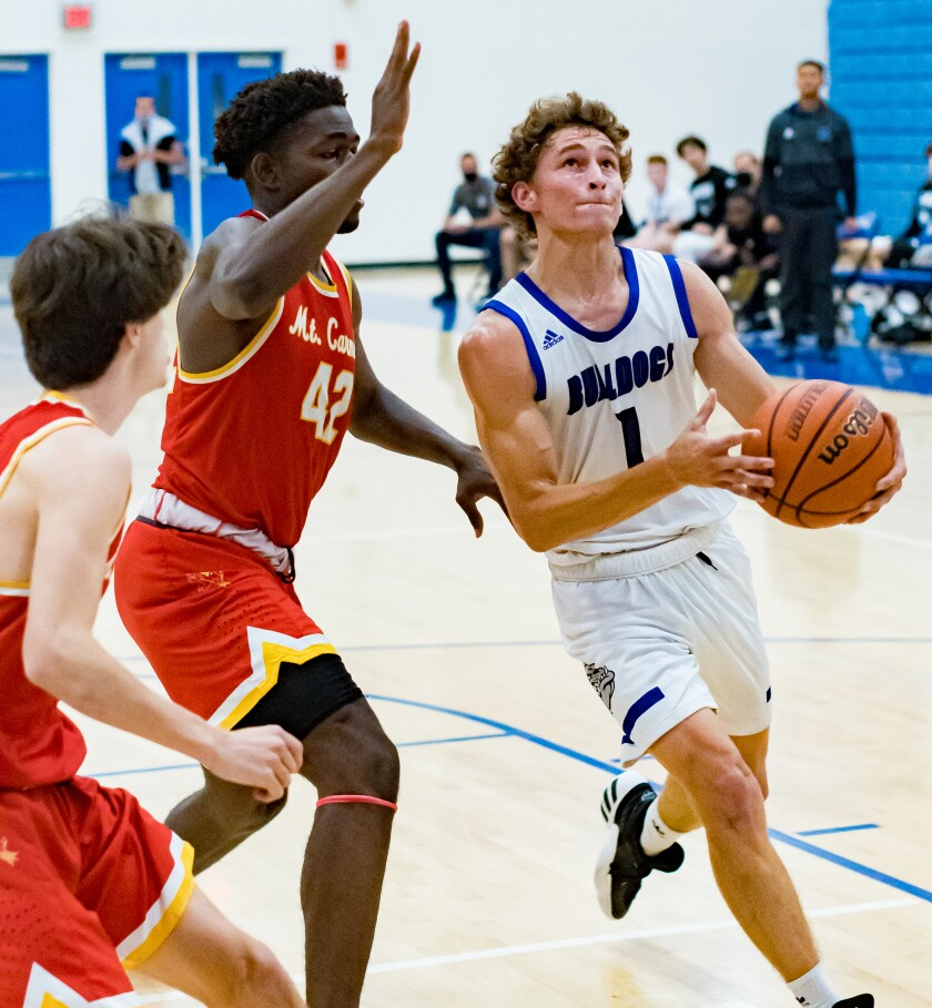Ramona High boys' basketball team celebrated a 66-54 victory against Mt. Carmel and claimed a Valley League champions title.