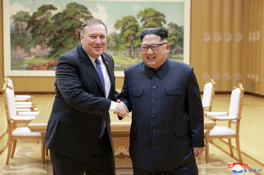 U.S. Secretary of State Mike Pompeo, left, shakes hands with North Korean leader Kim Jong Un during a meeting at Workers' Party of Korea headquarters in Pyongyang, North Korea, on May 9, 2018.