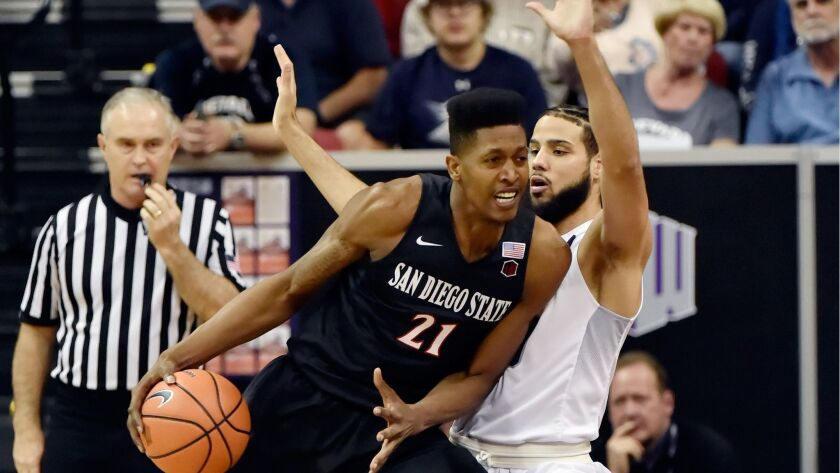 SDSU's Malik Pope drives the ball against Caleb Martin of Nevada during a semifinal game of the Mountain West tournament at the Thomas & Mack Center in Las Vegas.