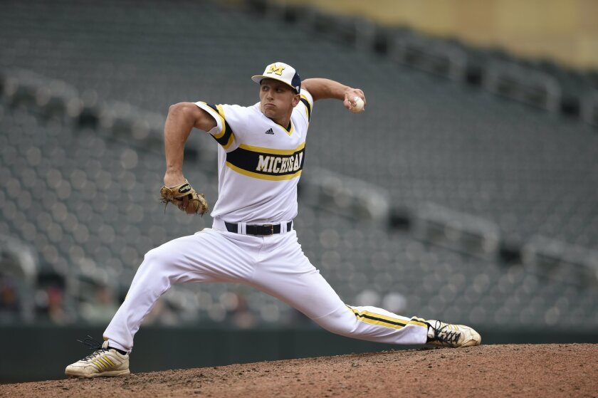FILE - In this May 23, 2015 file photo, Michigan relief pitcher Carmen Benedetti (43) delivers against Illinois during a fourth-round NCAA Big Ten tournament college baseball game in Minneapolis. Benedetti is one of the country's top two-way players. He led the Big Ten with 25 doubles and 71 RBIs a