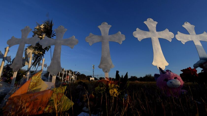 Memorial crosses stand in Sutherland Springs, Texas, to honor the people killed in the mass shooting at a church Sunday.