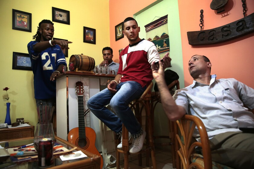 Omar Sayut, left, Angel Yunier, center, and Jose Daniel Ferrer, right, are very active in the Cuban dissident community. Ferrer spent eight years in a Cuban jail, and Yunier was freed in January after nearly two years in jail. Sayut uses his music to criticize the Castro administration.