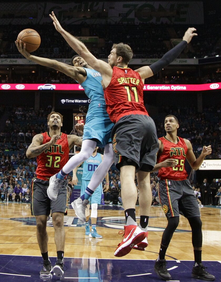 Charlotte Hornets' Jeremy Lamb, back, drives against Atlanta Hawks' Tiago Splitter, front, in the first half of an NBA basketball game in Charlotte, N.C., Sunday, Nov. 1, 2015. (AP Photo/Chuck Burton)
