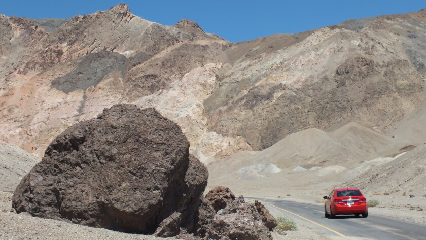 A car travels Artist's Drive, a scenic loop in Death Valley National Park, in 2013.