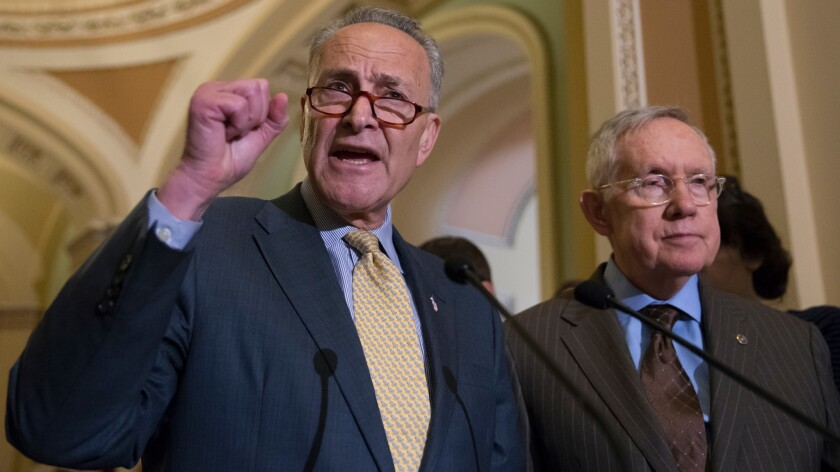 Sen. Charles Schumer, D-N.Y., joined at right by Senate Minority Leader Harry Reid of Nev., criticizes Republican lawmakers for being too tied to the NRA and the gun lobby on June 14.