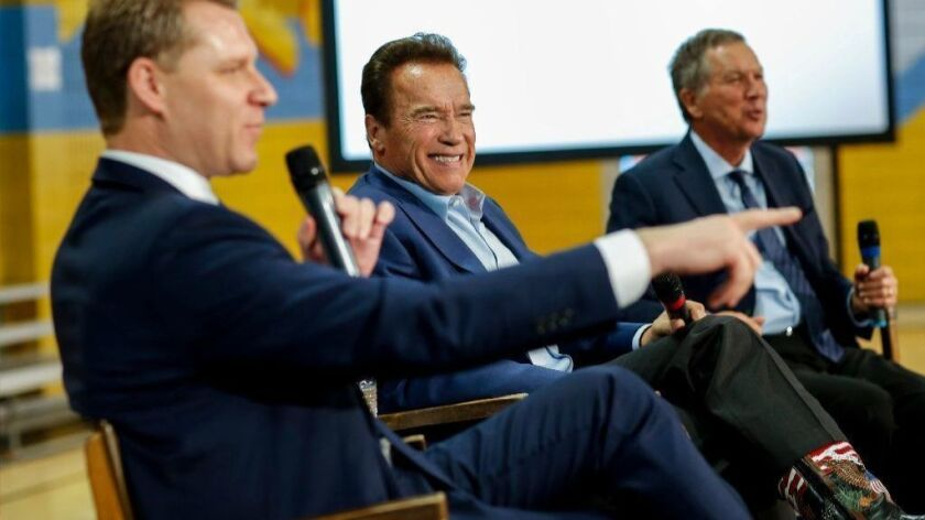 Assemblyman Chad Mayes, left, former Gov. Arnold Schwarzenegger and Ohio Gov. John Kasich at an event in Los Angeles on March 21.