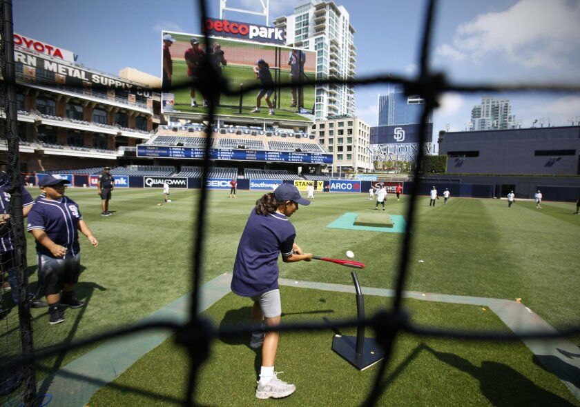 Carlos Macias, a student at Sliver Wing Elementary School hits during surprise baseball clinic hosted by the San Diego Padres at Petco Park.