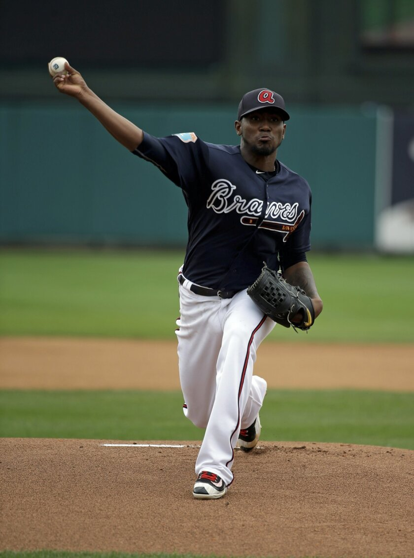 Atlanta Braves starting pitcher Julio Teheran throws in the first inning against the Houston Astros in a spring training baseball game, Friday, March 25, 2016, in Kissimmee, Fla. (AP Photo/John Raoux)
