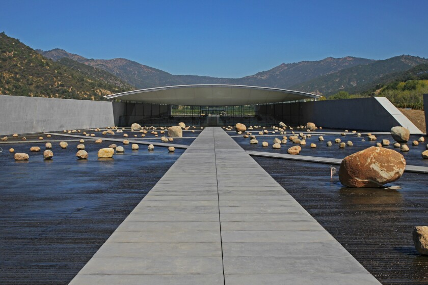 A dramatic water plaza punctuated by rocks greets visitors to Vik Vineyard in Chile's Central Valley. The winery complex was designed by Smiljan Radic, who did the Serpentine Pavilion in London in 2014.