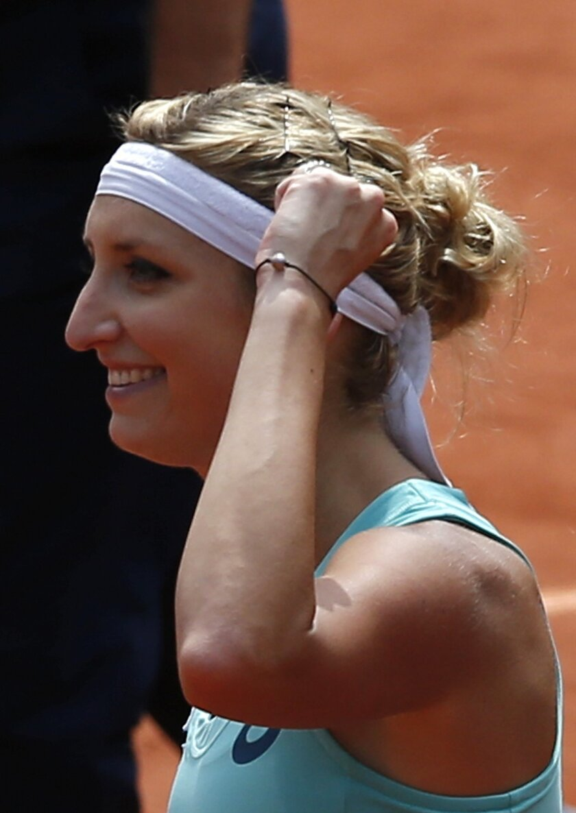 Timea Bacsinszky of Switzerland reacts as she defeats France's Pauline Parmentier during their third round match of the French Open tennis tournament at the Roland Garros stadium, Saturday, May 28, 2016 in Paris.  (AP Photo/Christophe Ena)