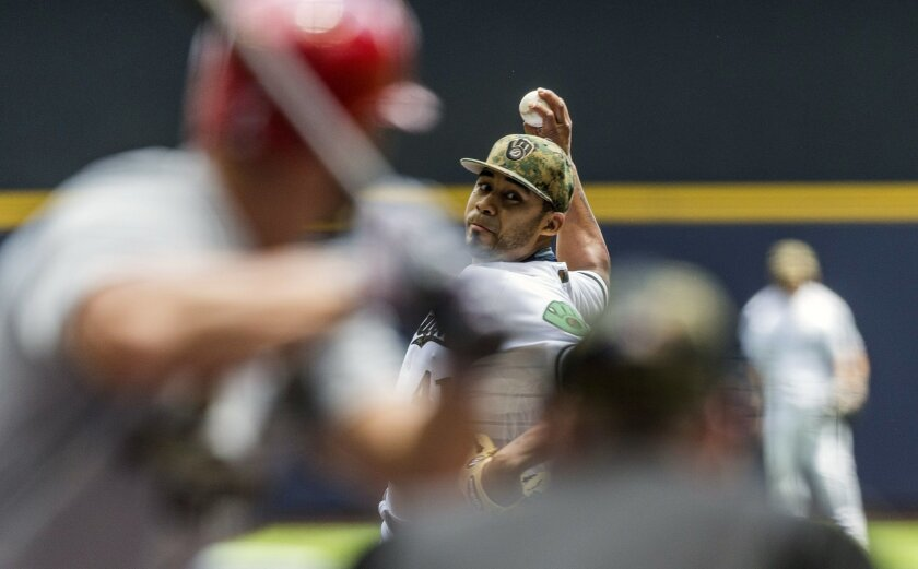 Milwaukee Brewers' Junior Guerra pitches to a St. Louis Cardinals batter during the first inning of a baseball game Monday, May 30, 2016, in Milwaukee. (AP Photo/Tom Lynn)