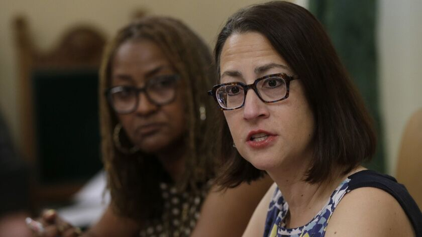 Assemblywoman Laura Friedman (D-Glendale), right, and state Sen. Holly Mitchell (D-Los Angeles) on Friday discuss a proposal for a new investigative unit to focus on harassment complaints in the Capitol.
