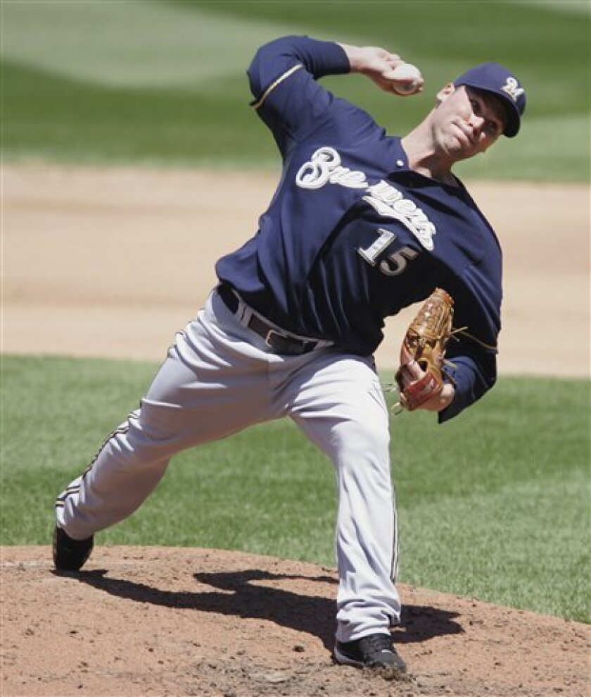 Milwaukee Brewers starting pitcher Ben Sheets (15) pitches against the Washington Nationals in the fifth inning of a baseball game at Nationals Park in Washington, Monday, May 26, 2008. (AP Photo/Lawrence Jackson)