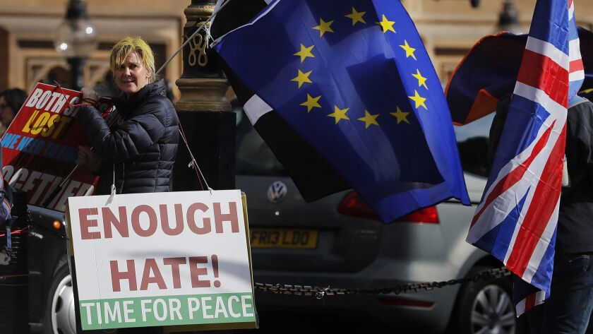 Brexit protesters demonstrate near the House of Parliament in London, Tuesday, March 26, 2019. Briti