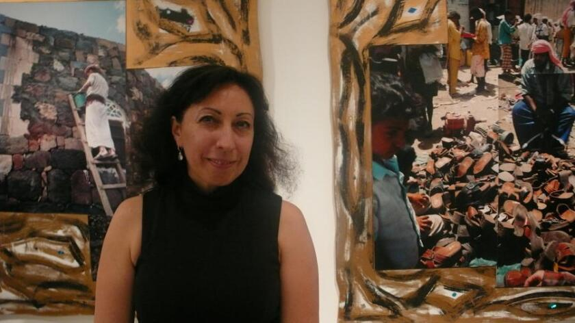 Tatiana Sizonenko with her art work, which is on view as part of the Extension of Photography exhibit.