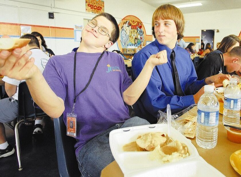 Clairemont High Circle of Friends member Preston Cale (left) showed his dance moves to Mark Bial during the club's Thanksgiving luncheon.