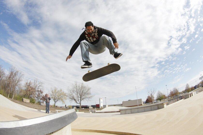 Kanten Russell tries out a skatepark he designed in St. Cloud, Minn.
