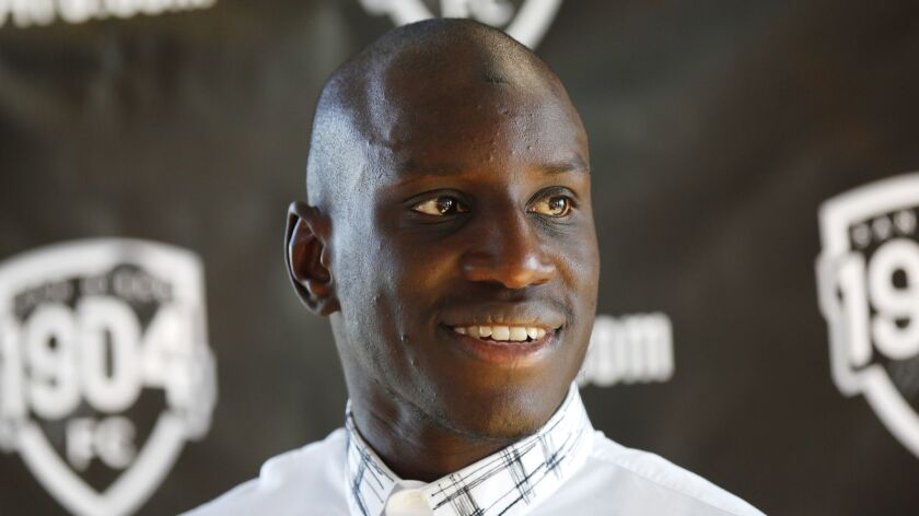 Senegalese soccer star Demba Ba, shown here at an October news conference, is the principal owner of San Diego's 1904 FC.