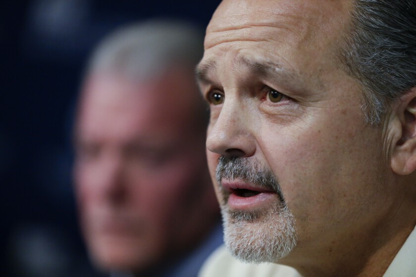 With team owner Jim Irsay looking on, Indianapolis Colts Coach Chuck Pagano speaks after the announcement of his new contract on Monday.