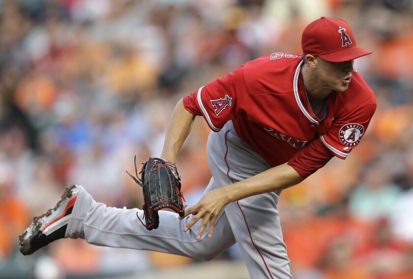Los Angeles Angels starting pitcher Tyler Skaggs follows through on a pitch to the Baltimore Orioles in the first inning of a baseball game, Thursday, July 31, 2014, in Baltimore. (AP Photo/Patrick Semansky)