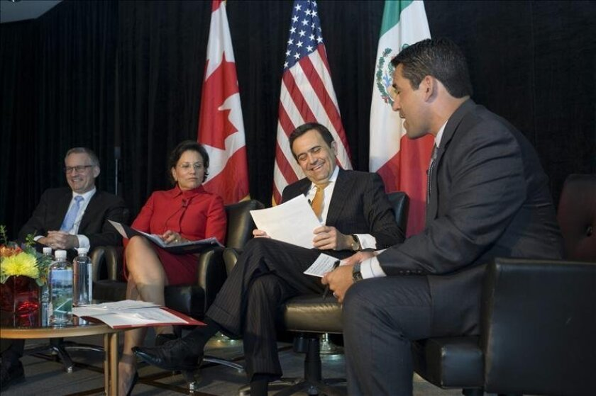 Pictured left to right are, Ed Fast, Canada's Minister of International Trade, Penny Pritzker, U.S. Secretary of Commerce, Ildefonso Guajardo Villareal, Mexico's Secretary of the Economy with MundoFox news anchor Rolando Nichols, who moderated their discussion Monday at the North American Competiti