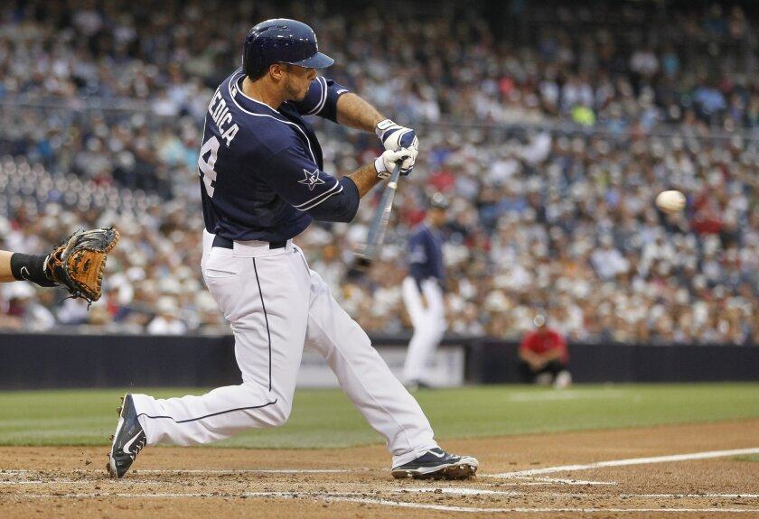 The Padres' Tommy Medica scores a run with a sacrifice fly in the first inning.