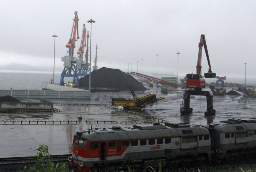 In this July 24, 2016 photo, coal brought from Siberia are be seen awaiting loading onto a ship bound for China in the North Korean special economic zone of Rason. Even as North Korea is facing tough sanctions, the zone is by North Korean standards thriving. For countries spearheading efforts to impose even stronger sanctions against the North for its recent nuclear test, it's an irritating reminder that not everyone is onboard with the idea of shutting off trade with Pyongyang, especially when there is money to be made. (AP Photo/Eric Talmadge)