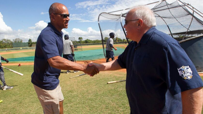 Padres special assistant Moises Alou greets Executive Chairman Ron Fowler on Feb. 1, 2017, at the team's training facility in the Dominican Republic.