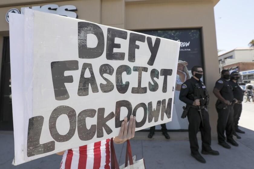 Coronavirus: Huntington Beach protesters slam stay-at-home orders ...