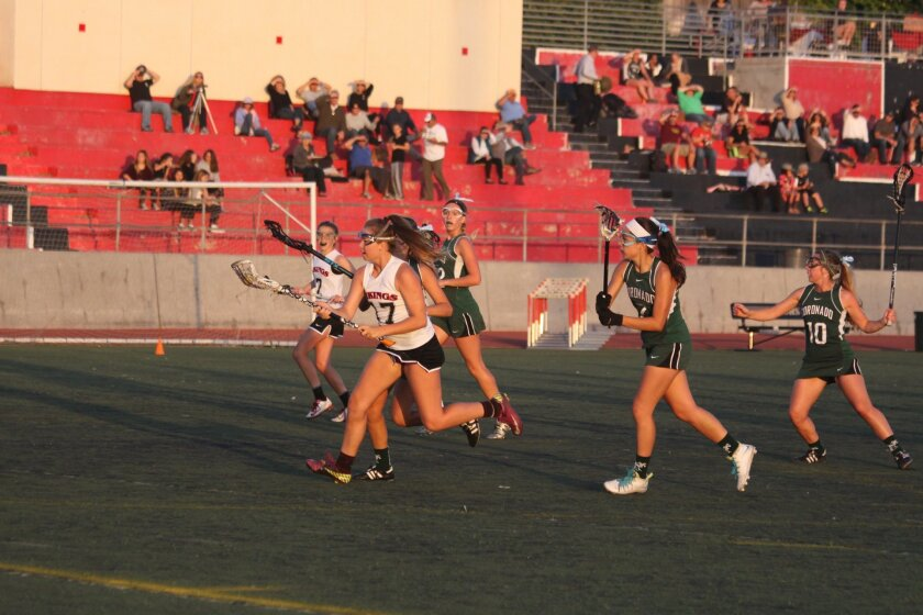 Senior Ashley Pretorius (No. 17) charges the goal with Coronado Islanders hot on her heels, April 17.