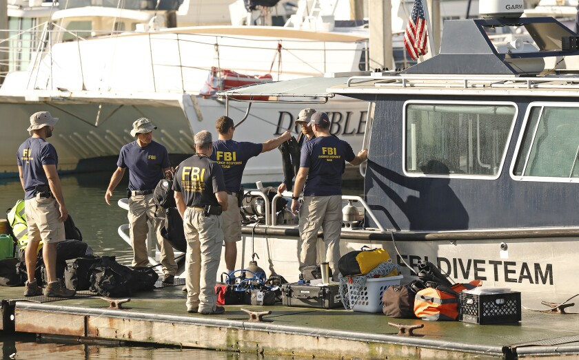 FBI dive team members prepare to go to the site of the dive boat Conception