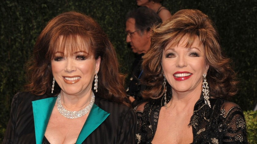 Joan Collins, right, poses with her sister, author Jackie Collins at the Vanity Fair Oscar party in 2009.