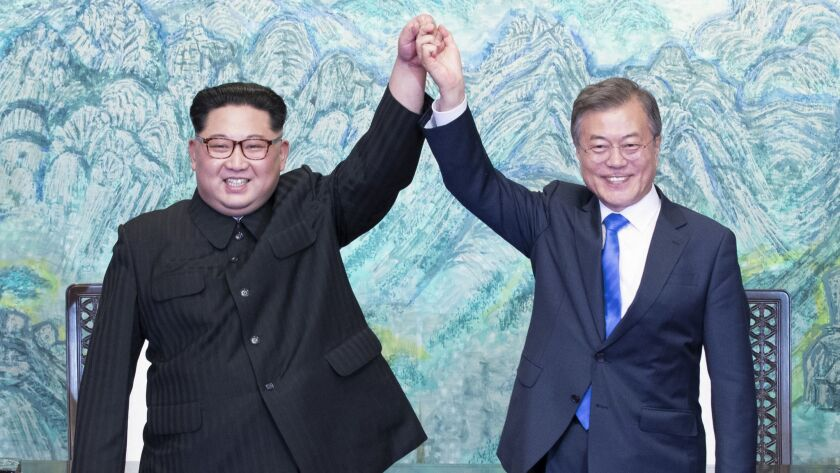 North Korean leader Kim Jong Un, left, and South Korean President Moon Jae-in after signing a joint statement on April 27.