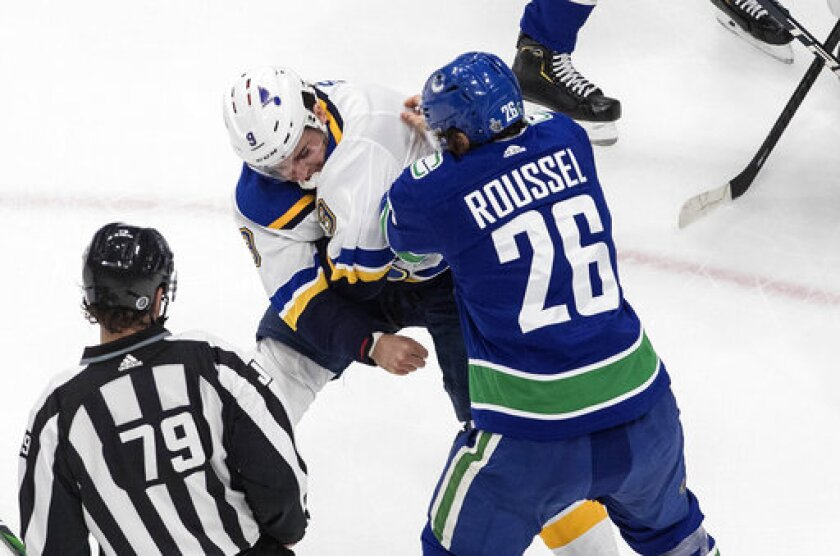 Vancouver Canucks' Antoine Roussel (26) and St. Louis Blues' Sammy Blais (9) fight during the first period of an NHL Western Conference Stanley Cup playoff game in Edmonton, Alberta, Monday, Aug. 17, 2020. (Jason Franson/The Canadian Press via AP)